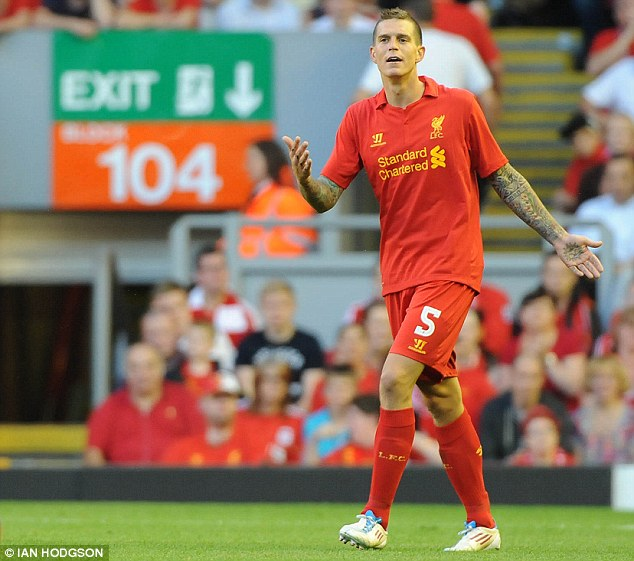 Dream move: Liverpool defender Daniel Agger admits he would leave Anfield for Barcelona if the Spanish giants come calling