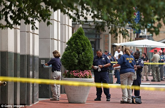 Local and federal investigators work to gather evidence after a security guard was shot in the arm at the headquarters of the Family Research Council
