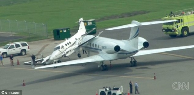 Accident: Aviation authorities are investigating after the Gulfstream G550 private jet, right, plowed into the Beechcraft King Air plane at Nashville International Airport