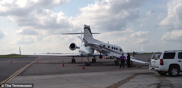 Grounded: The King Air jet, right,  was another corporate jet owned by Memphis-based West Air Holdings, and was due to depart Nashville about a half hour after the incident
