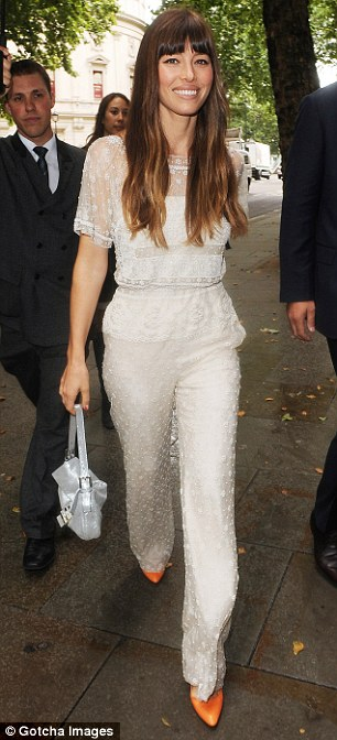 Lovely in lace: Jessica wowed in a stunning lace jumpsuit and bright orange heels as she arrived at London's Corinthia Hotel earlier today
