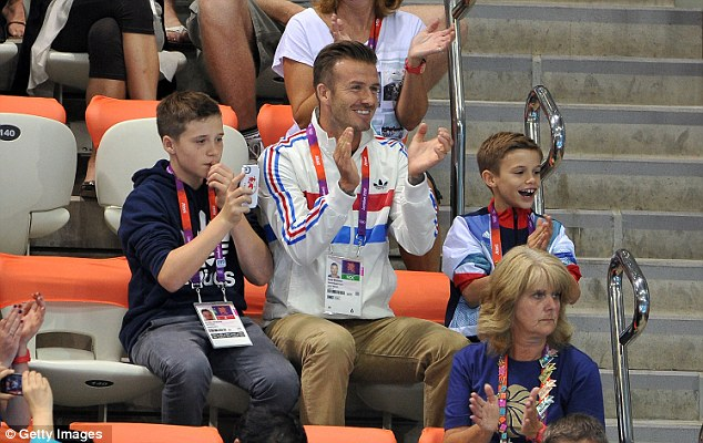 Ambassador: Beckham lent his support to Team GB during the London 2012 Olympics, including taking his sons to see Tom Daley in action