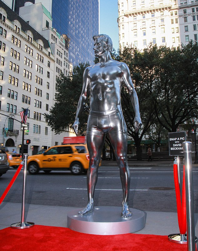 Larger than life: A silver statue of David Beckham has been erected in New York to promote his new underwear line for H&M