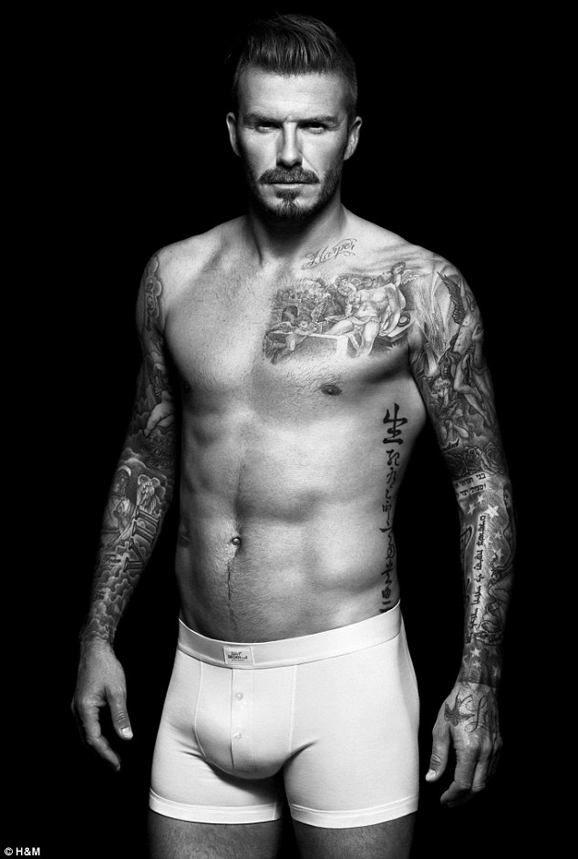 Smouldering: The footballer shows off his tone physique and many tattoos in the black and white shots