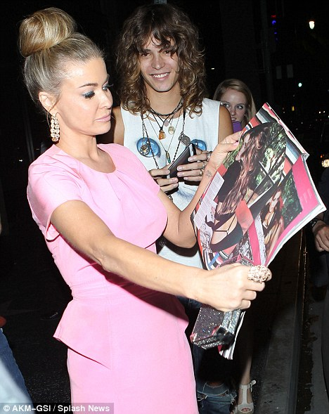 Look at me: Carmen diligently flips through the magazine for her admiring fans