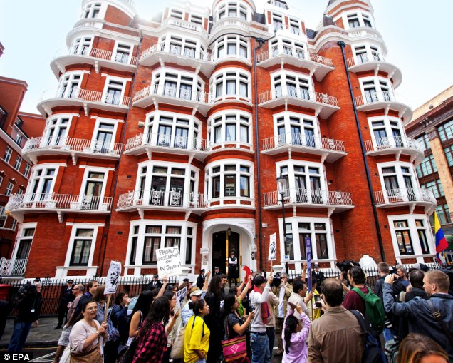 Supporters of Julian Assange gather outside the Ecuador embassy in Knightsbridge yesterday, where he has taken refuge since June