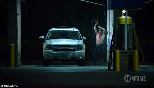 Cleaning away the evidence: The U.S. Marine is seen washing himself down at a gas station