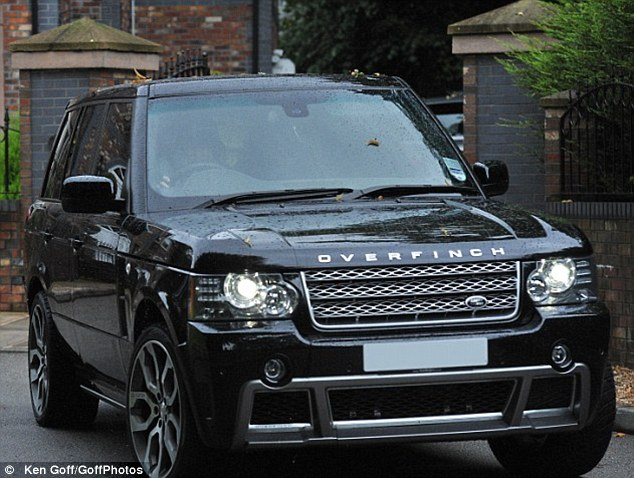Car number two: The £95,000 Overfinch Range Rover, which the couple bought in black for a bit of diversity