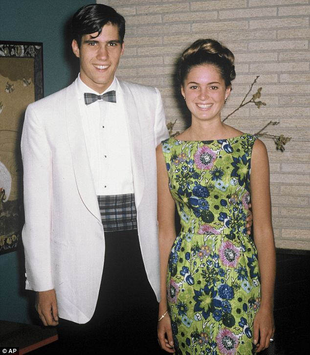 All dressed up: Mitt looks dapper in his white jacket and checked bow tie, posing next to his future wife before his senior prom