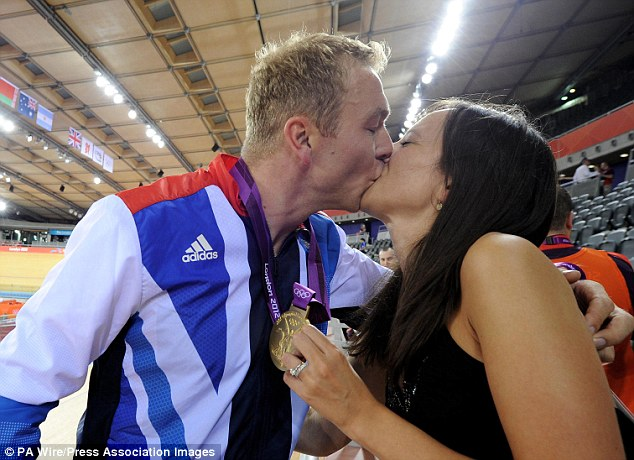 Family man: Sir Chris Hoy celebrating his gold medal with his wife Sarra after he won the Team Sprint Final at the Velodrome