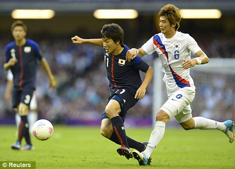 In demand: Celtic's Ki Sung Yueng (right) will hold talks with Swansea