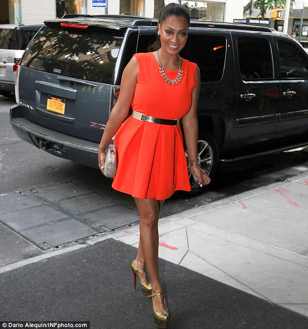 Bright and beautiful: Vasquez looked great in an orange frock and gold designer heels