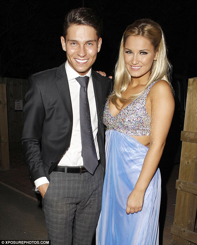 Happy couple: Sam and her boyfriend Joey Essex posed for photos before making their way into the party