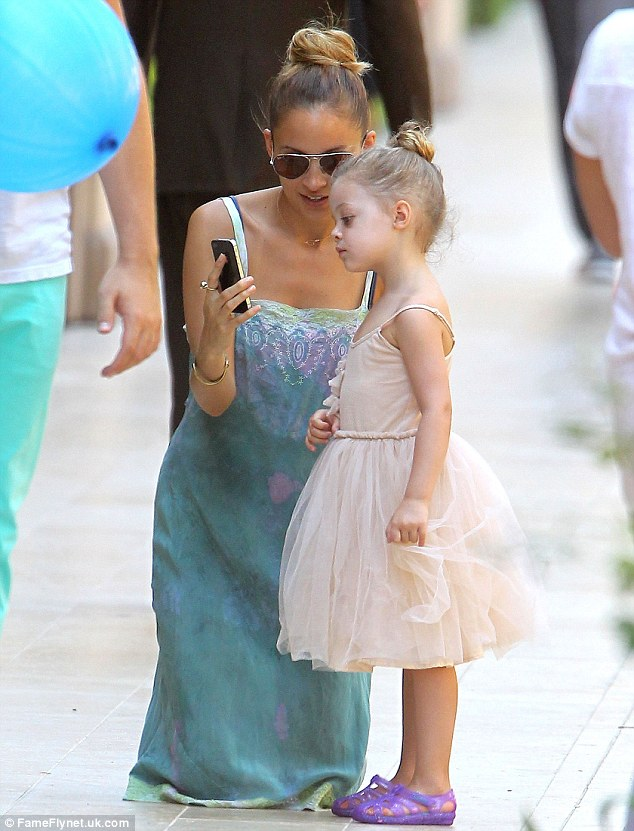 Little princess: Mother and daughter, with matching hairstyles, share a private moment
