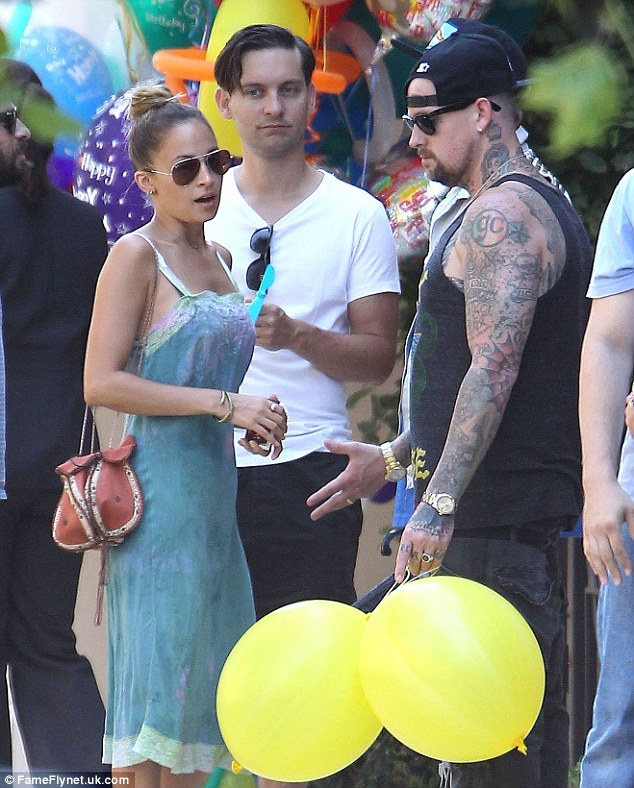 Party people: Among the other guests at the party were actor Tobey Maguire and Nicole's brother-in-law and Good Charlotte rocker  Benji Madden.