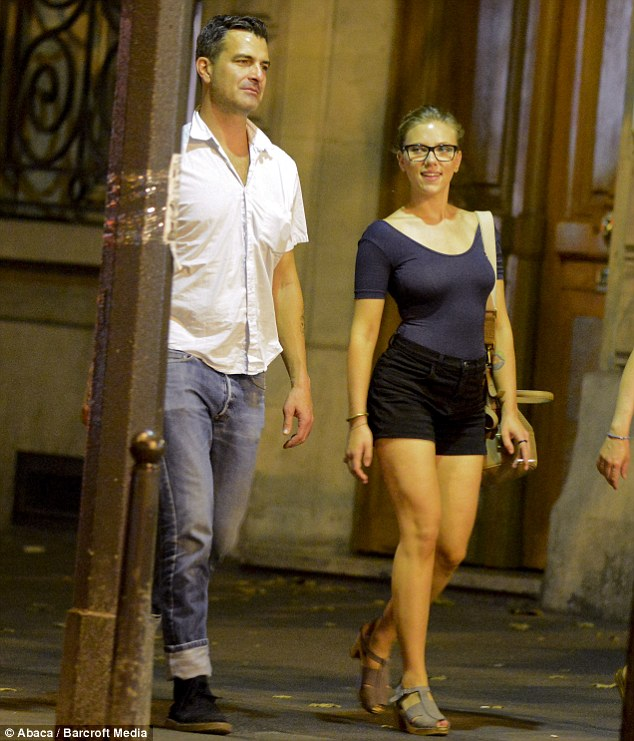 Sexy in specs: Scarlett wore a blue leotard-style top with a pair of black shorts and tan heels, with her blonde hair scraped back into a bun for the early evening stroll