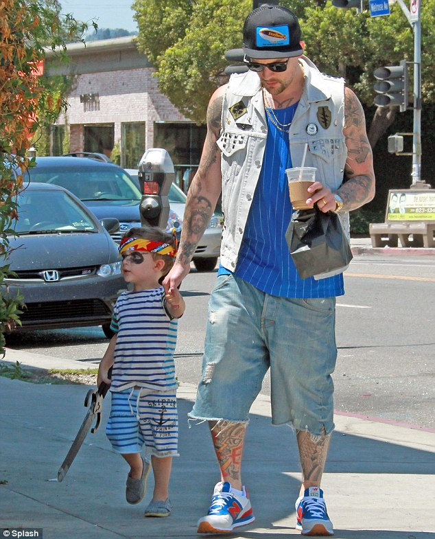 What no cake?: After the party Joel took his son, now complete with eye-patch, out for an iced coffee