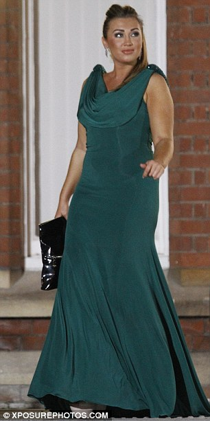 Green with envy? Lauren Goodger, who has always had a volatile friendship with Lucy, wore a bottle green maxi dress for the party
