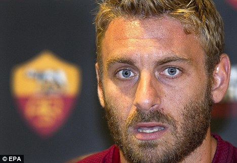 Staying put: Daniele De Rossi claims he will remain at Roma
