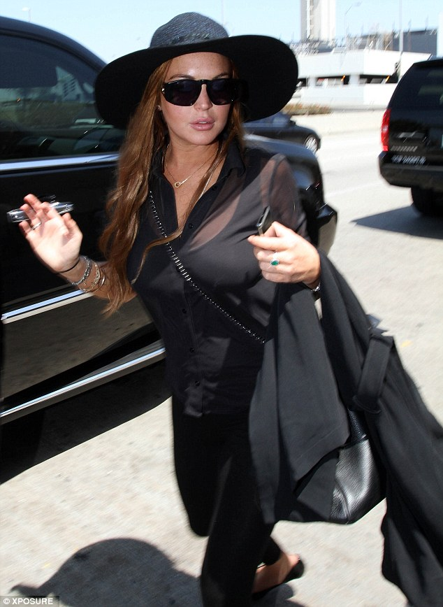 Heading off: Lindsay departed LA after being questioned by police as a potential witness to a theft