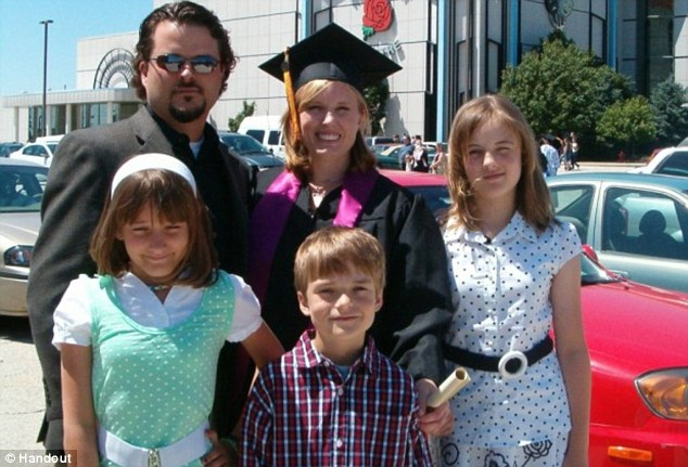 Tragedy: Christopher and Kimberly Vaughn with their children (from left) Cassandra, Blake and Abigayle at Mrs Vaughn's graduation ceremony in Chicago