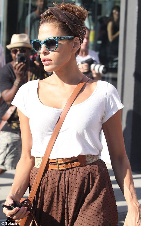 All about the accessories: Eva added turquoise sunglasses and a headband to complete her elegant look