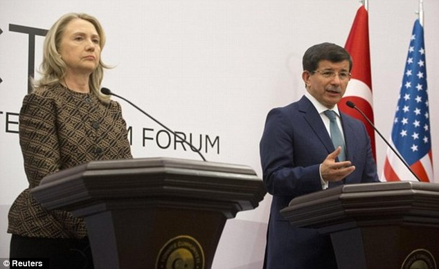 Diplomacy at work: Secretary of State Hillary Clinton, left, and Turkish Foreign Ahmet Davutoglu, right, met in Istanbul this month to announce the creation of a Syria response team