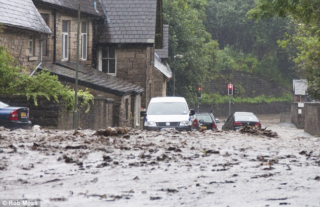 The Environment Agency had issued a flood alert along the River Irwell, but these motorists in Ramsbottom were still caught on the hop