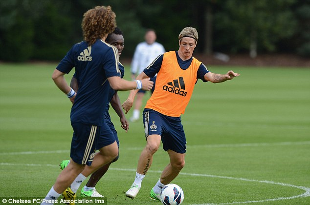 Forward thinking: Fernando Torres is put through his paces ahead of Chelsea's clash with Reading