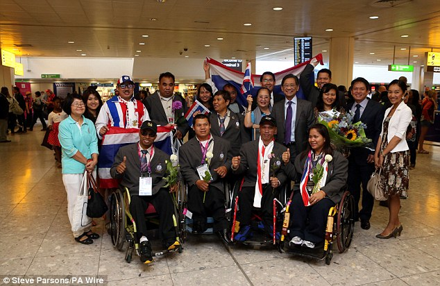 Welcome to London: Paralympians from Thailand arrive at Heathrow a week before the start of the Games