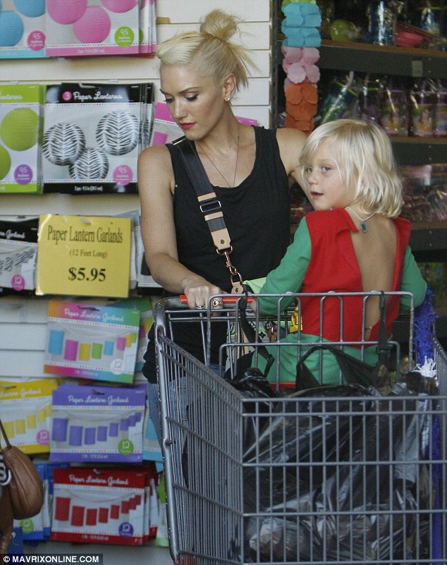 Fun ride: Zuma sat in the front of the shopping cart, while Gwen pushed it up and down the aisle as they perused for fun items