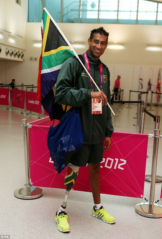 Flying the flag: Achmat Hasseim, a Paralympian from South Africa, decorated in the colours of his country