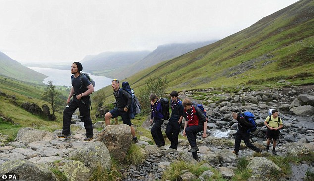 Hardy band: The group of youngsters and two Scout leaders scaled the 978-metre summit of Scafell Pike in Cumbria