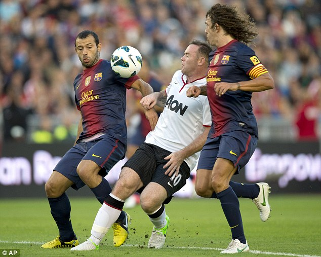Rival teams: Wayne Rooney playing Barcelona FC in a friendly on August 8