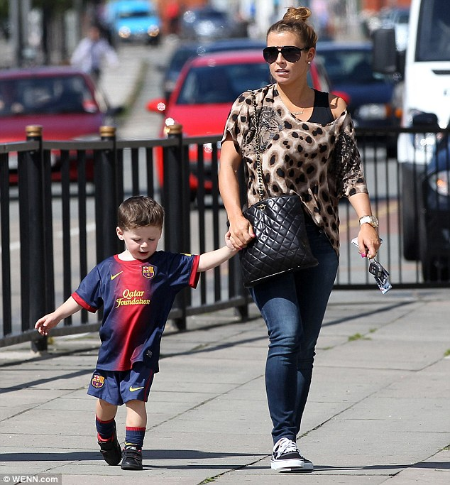 Hola! Coleen Rooney's son Kai wears a Barcelona FC football shirt as they leave lunch at Pod restaurant in Liverpool
