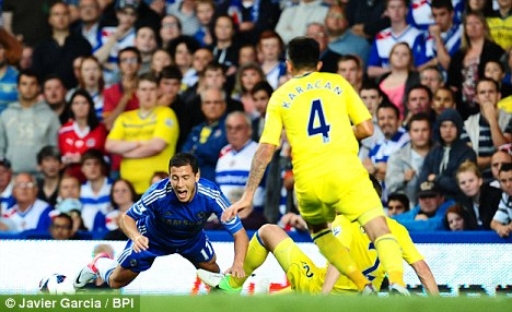 Eden Hazard of Chelsea goes down in the area to earn the penalty which gave his side the lead