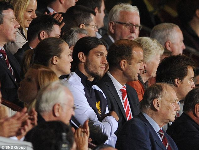 Carroll watches from the stand