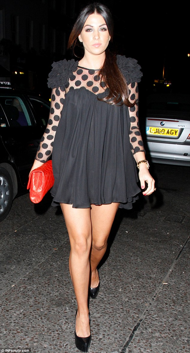 Daring: Cara Kilbey wore a black shift dress which had sheer spotted sleeves and a petaled shoulders