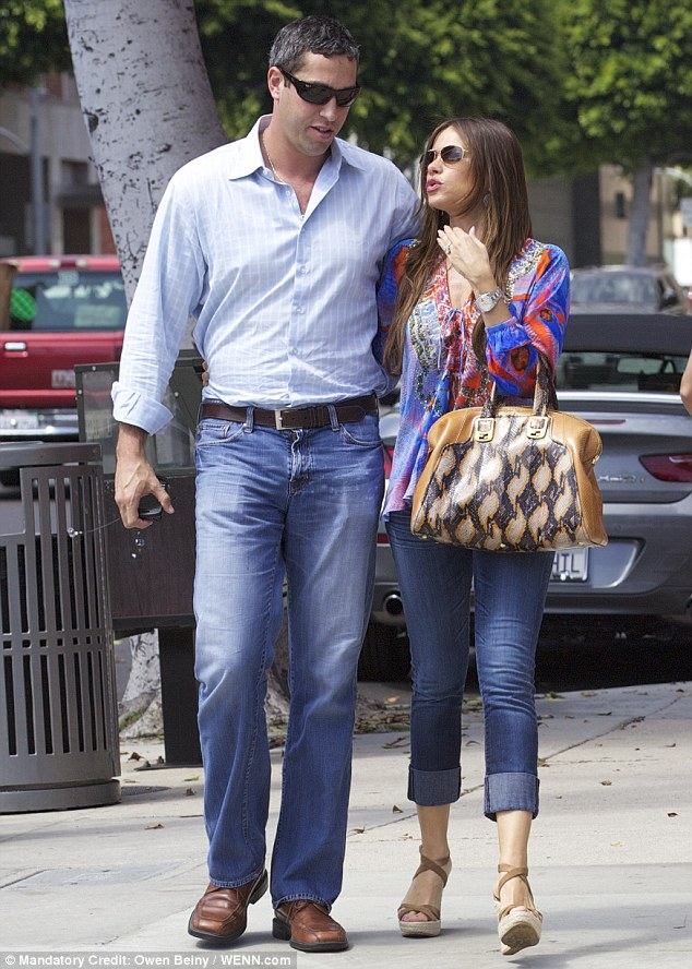Casual outing: The Colombian TV star also showed off her sensational curves in a pair of cuffed skinny jeans which she paired with a patterned blouse and platform wedges