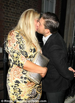 Loved-up: Arg was clearly a fan of his girlfriend's new look as he surprised her with a kiss and an ear nibble