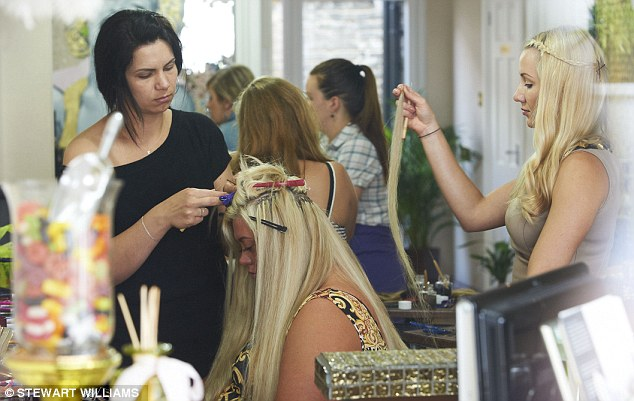 Help at hand: The stylists spent hours beautifying Gemma's locks as she sat reading copies of the latest magazines
