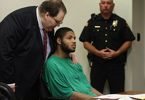 Trial: Shamsid-Din Abdur-Raheem listens to his attorney Richard Klein while being arraigned by Judge Frederick DeVesa in State Superior Court in New Jersey