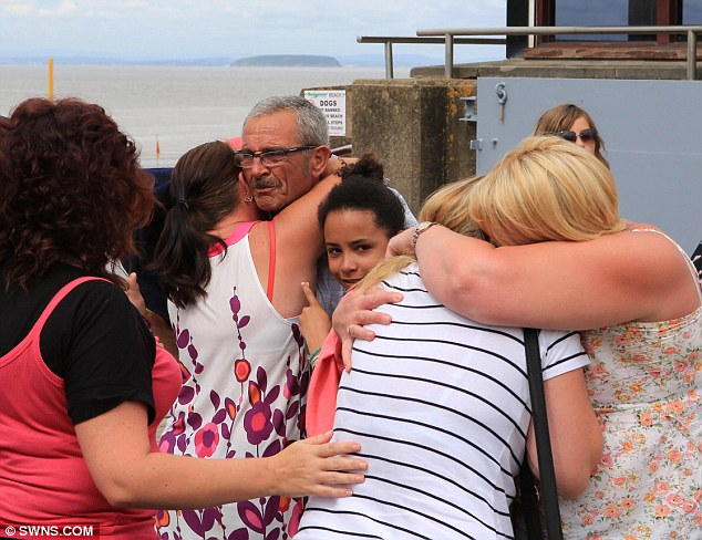 Ordeal: Friends and relatives of Dylan Cecil react to the news that a body has been found in the water
