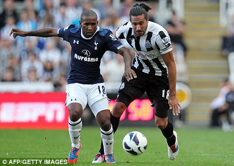 Off and running: Jermain Defoe (left) scored on the opening day of the season