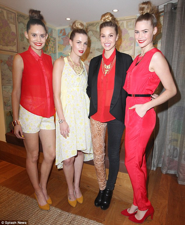 Odd girl out: Whitney posed with models all dressed in her label, Whitney Eve