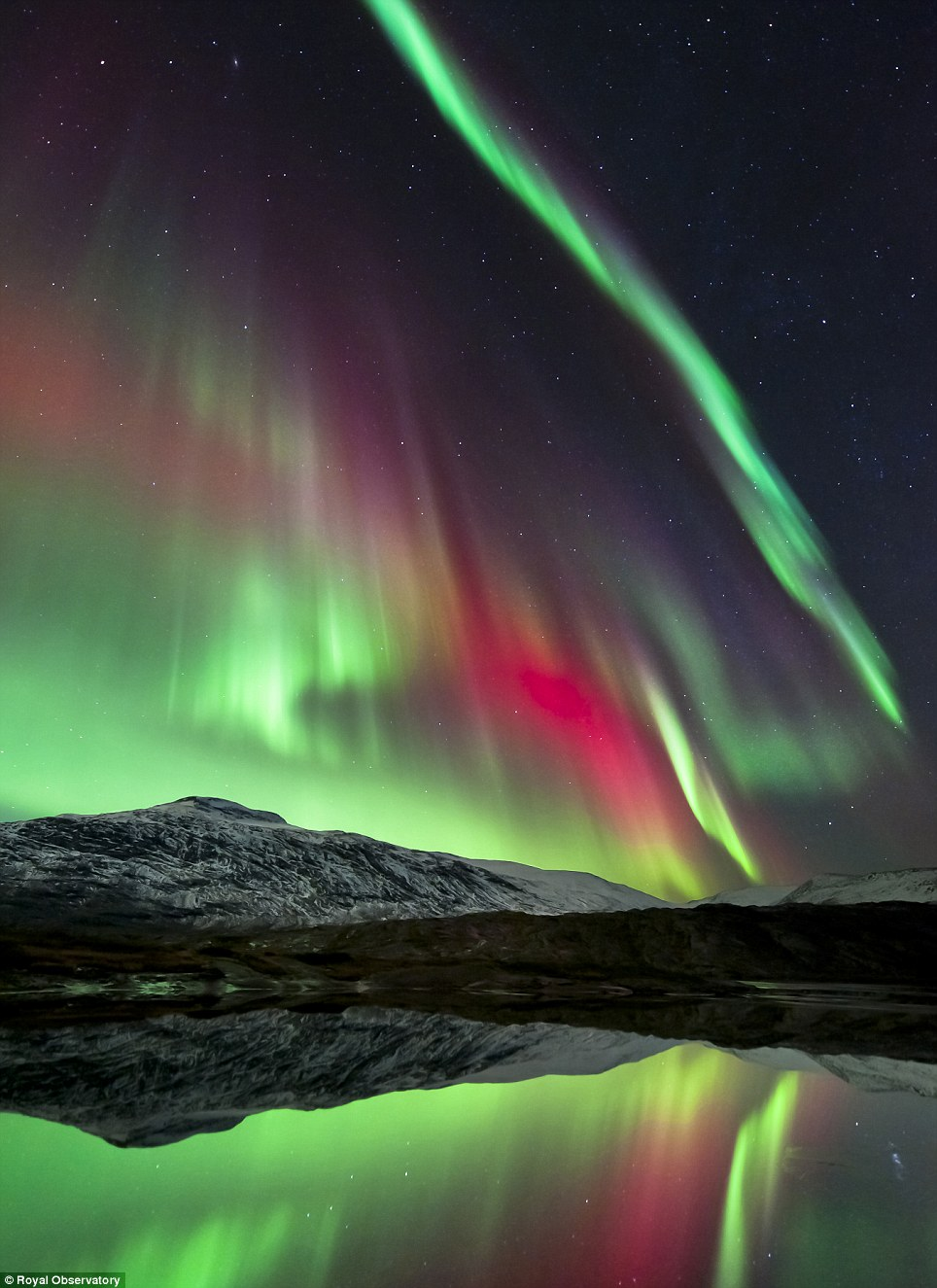 The dazzling Aurora Borealis over Hgtuva Mountain in Norway is captured with its shimmering neon lights