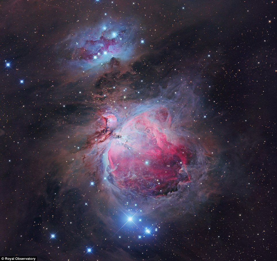 In the centre of the Orion Nebula newly-formed stars blast their surroundings with radiation, carving out a cavity in the dust and causing the hydrogen gas to glow pink