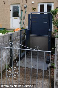 'Imprisoned': Pictured is the heavy-duty lift installed outside Caroline's house in a bid to encourage her out of the building