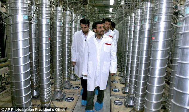 Weapons: President Mahmoud Ahmadinejad visits the Natanz Uranium Enrichment Facility amid concerns over possible weapons accumulation