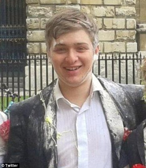 Apologies: The guide's author, Tom Beardsworth (pictured), in a picture taken after some student high-jinks and posted on his Twitter profile